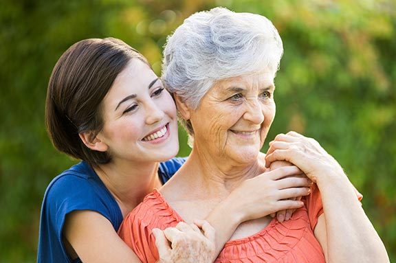 Senior woman with daughter outside arm and arm